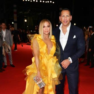 Jennifer Lopez and Alex Rodriguez discussing options for wedding plans