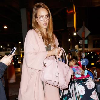 Jessica Alba listens to 'dope music' during glam