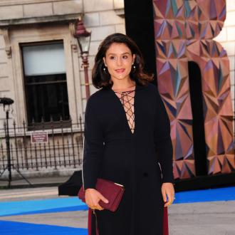 Jessie Ware using phone to write cook book