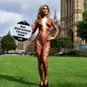 Joanna Krupa strips off outside parliament for ban on wild-animal circuses