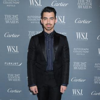 Joe Jonas teases his brother Nick about dating Delta Goodrem