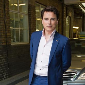 John Barrowman has 'champagne problems'