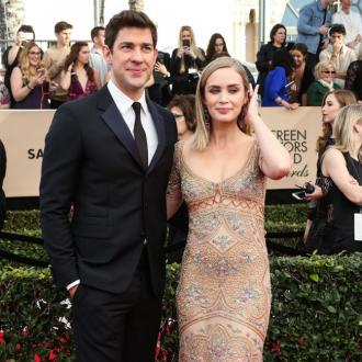 John Krasinski's wife Emily Blunt keeps him on 'track'
