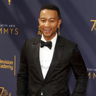 John Legend taught to swim by Olympic athlete Ryan Lochte