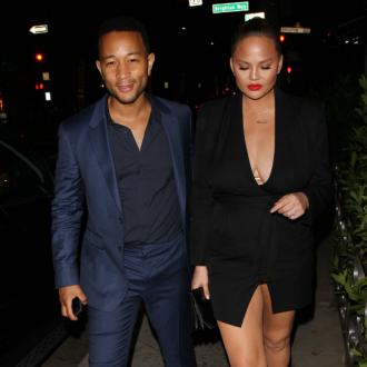 Chrissy Teigen says John Legend is an 'aggressive cuddler'