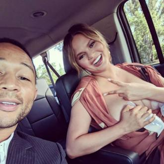 Chrissy Teigen breast-pumps on the way to dinner date