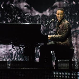 John Legend gets gyrating fan on stage at The O2