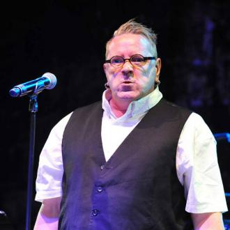 John Lydon hit with glass bottle on stage
