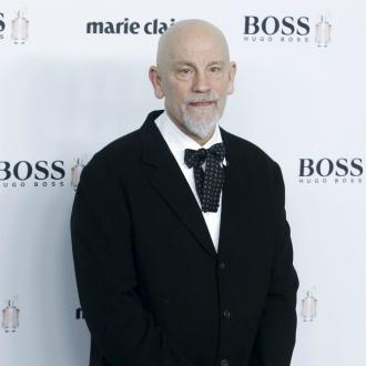 John Malkovich: Lost millions meant more work