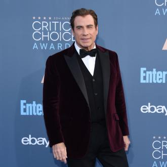 John Travolta 'proud' of Olivia Newton-John