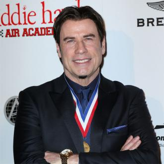 John Travolta vows to take on Benedict Cumberbatch in dance-off