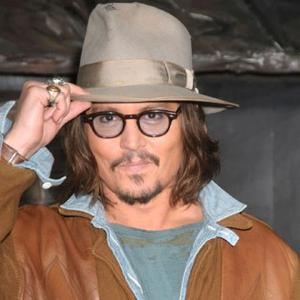 Gq Awards Guest Johnny Depp Watches Ceremony On Tv