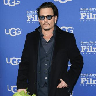 Johnny Depp Defends Use Of Earpiece