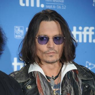 Johnny Depp Hurts Back On Lone Ranger