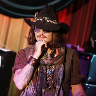 Johnny Depp performs with Aerosmith