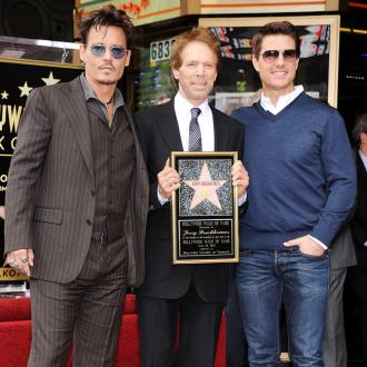 Johnny Depp and Tom Cruise toast Jerry Bruckheimer