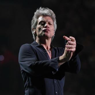Jon Bon Jovi holding fan cruises