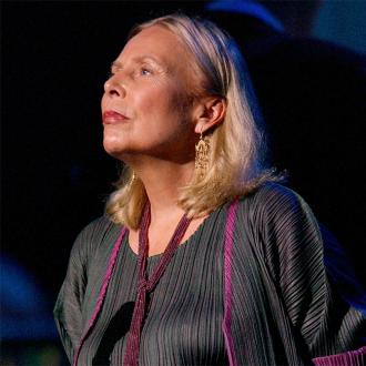 Joni Mitchell 'speaking well'