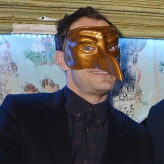 Jude Law Hides Behind Mask At The Box