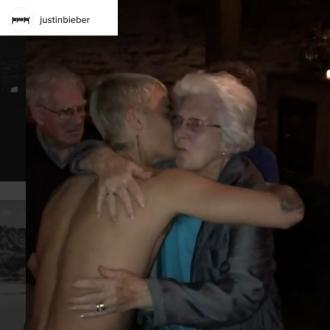 Justin Bieber dances topless with elderly woman