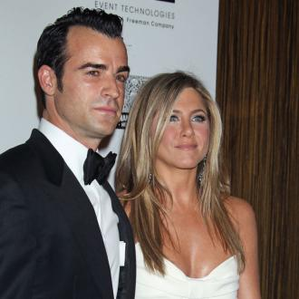 Jennifer Aniston Asks Justin Theroux For Wedding Gown Advice