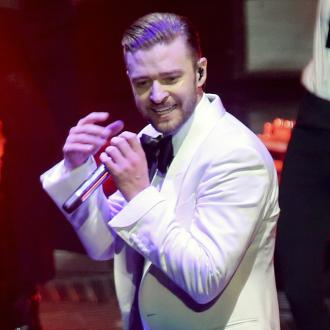Justin Timberlake poses with fan during gig