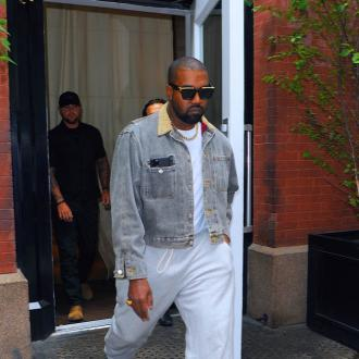 Kanye West signs 10-year deal with Gap
