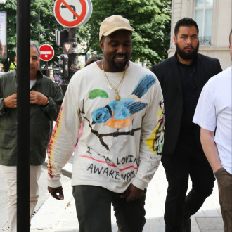 Kanye West goes incognito in full face covering at Balenciaga show