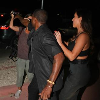 Kanye West Tries To Snatch Paparazzo's Camera