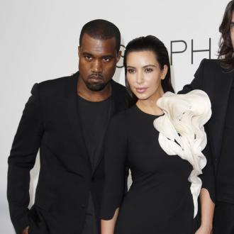 Kanye West Bans Kim Kardashian From Cosmetic Surgery