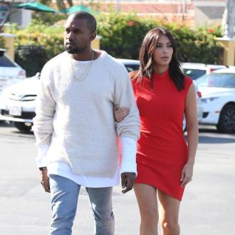 Kim Kardashian And Kanye West Go Biking