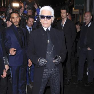 Karl Lagerfeld Stages Protest At Paris Fashion Week