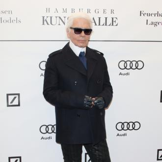Karl Lagerfeld doesn't sit around