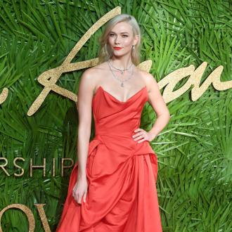 Karlie Kloss tried to stop herself from growing
