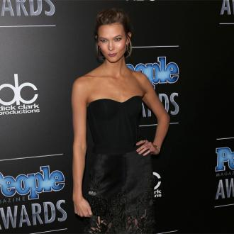 Karlie Kloss is happy to be a role model