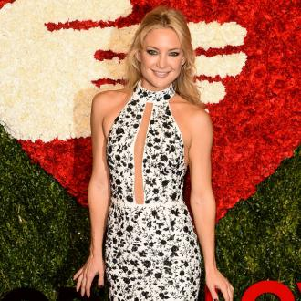 Kate Hudson Practices Yoga On Aeroplanes