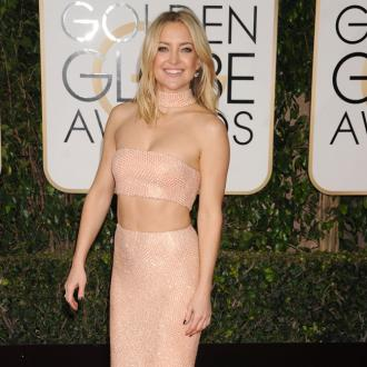Kate Hudson stands with Time's Up