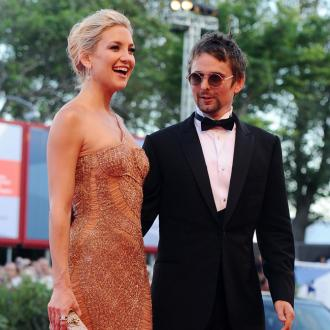 Kate Hudson and Matt Bellamy act 'extremely happy'