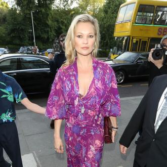 Kate Moss uses 'lube' to fit into latex dress