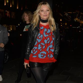 Kate Moss happy to use public transport