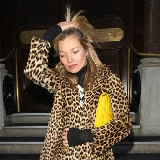 Kate Moss sells famous leopard coat