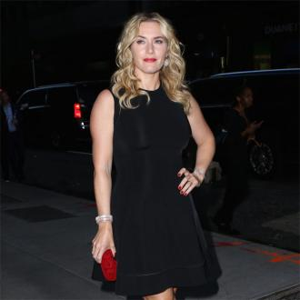 Kate Winslet Celebrates Hollywood Film Awards Success With Allison Kiss
