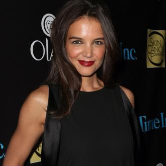 Katie Holmes keeps her prom dress in storage