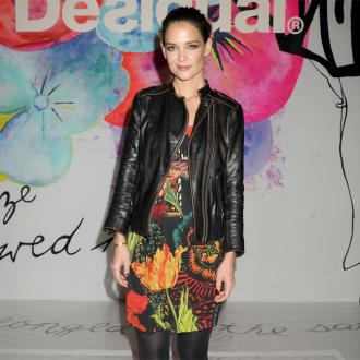 Katie Holmes 'loves' wearing men's clothes