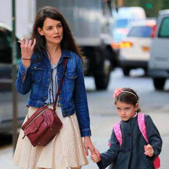 Katie Holmes Planning To Adopt?