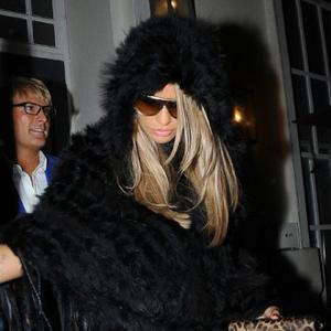 Katie Price's Wild Antics At Elton Party