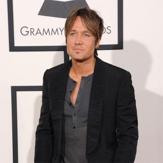 Keith Urban dedicates song to Ed Sheeran and his new wife