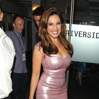 Kelly Brook's board game fun with Brad Pitt