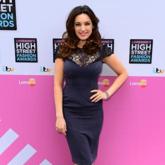 Kelly Brook living with Gladiator boyfriend