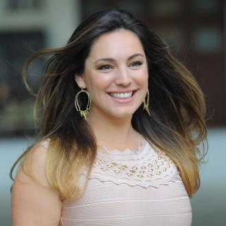 Kelly Brook gets nude on One Big Happy